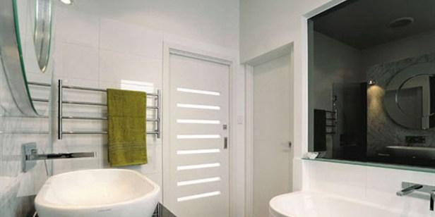 baño luminoso por espejos